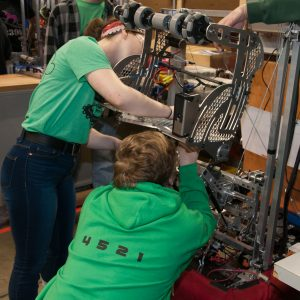The students from team 4521 work on their robot in the pits area at the 2019 Buckeye Regionl Robotics Competition.