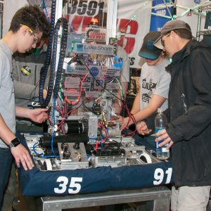 The students from team 3591 work on their robot in the pits area at the 2019 Buckeye Regionl Robotics Competition.