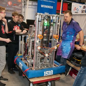 The students from team 1518 work on their robot in the pits area at the 2019 Buckeye Regionl Robotics Competition.