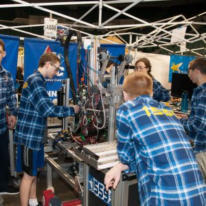 The students from team 1559 work on their robot in the pits area at the 2019 Buckeye Regionl Robotics Competition.