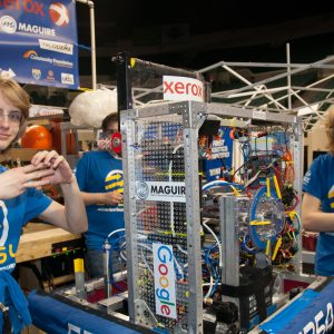 The students from team 5254 work on their robot in the pits area at the 2019 Buckeye Regionl Robotics Competition.