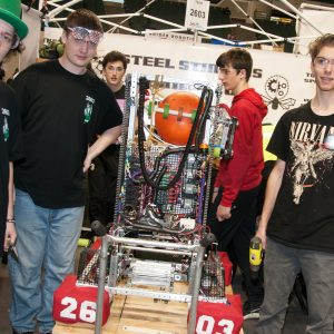 The students from team 2603 work on their robot in the pits area at the 2019 Buckeye Regionl Robotics Competition.