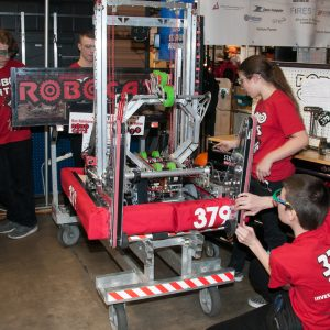 The students from team 379 work on their robot in the pits area at the 2019 Buckeye Regionl Robotics Competition.