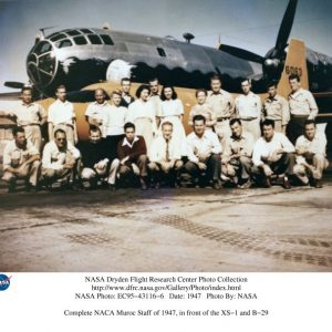 Group in front of bomber.