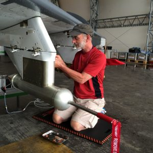Instrument being installed on an aircraft.