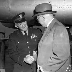 General Arnold and George Lewis shake hands
