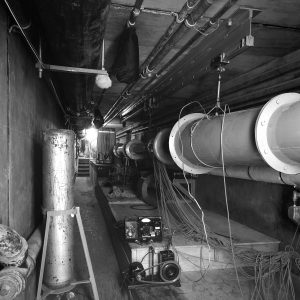 Tunnel and pipes in basement hall.