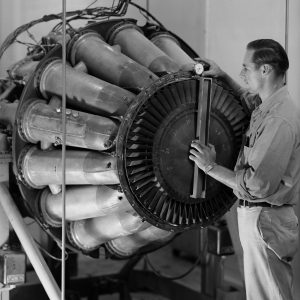 A mechanic checks out a GE I-40 engine equipped with a tailpipe burner (1946)