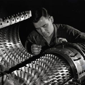 Man examining compressor.