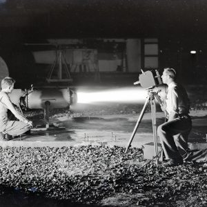 Man filming engine test.