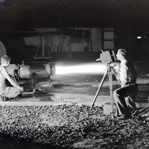 Man filming engine test.
