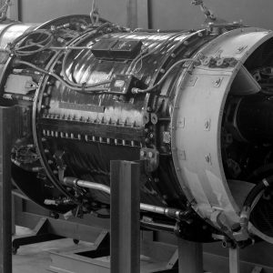 A TG-190 engine on stand in shop area.
