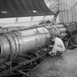 Mechanics work on TG-190 engine in AWT test section.