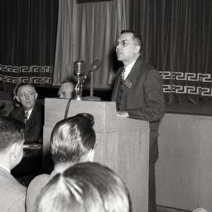 Dryden at podium.