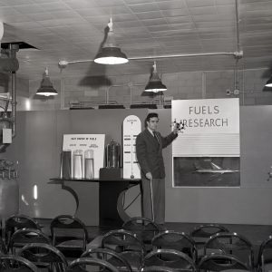 Man with Fuels research exhibit.
