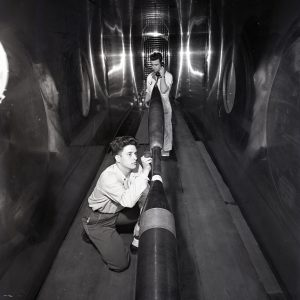 Men with missile in tunnel.