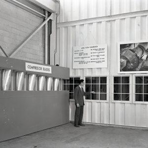 Man with compressor blade exhibit.