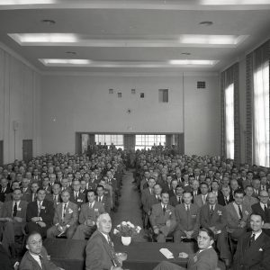 Guests seated in auditorium.