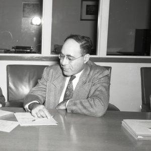 Pinkel at desk.