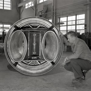 Man examining engine inlet duct.