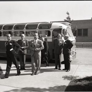 Men exiting bus.