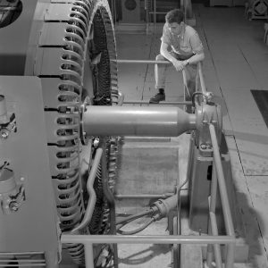 Technician with Compressor in Exhauster Building Addition.