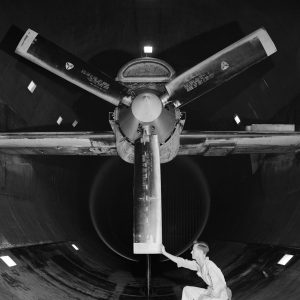 A mechanic examines the Allison T-38 inside the AWT's test section.