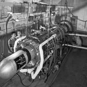 Engineers inspect a GE TG-190 engine installed in Cell 6