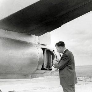 Man at rear of aircraft.