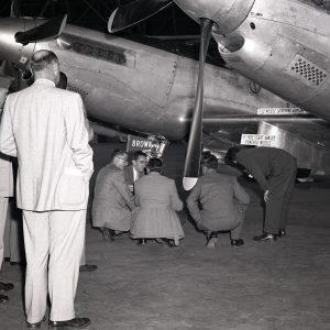 Men looking at aircraft engine.