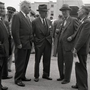Five men standing.