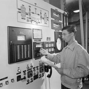 Man adjusting control panel