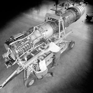 Mechanics prepare a General Electric J-79 turbojet for testing in PSL