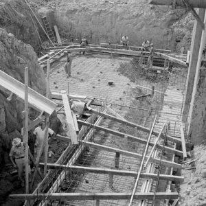 Crew laying foundation.