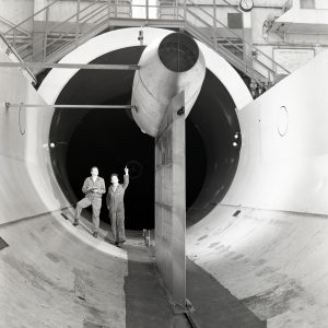 Technicians examine Pratt & Whitney J57 engine installed in the Altitude Wind Tunnel test section.