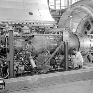 John McAulay (to the right) and a technician install the Orenda Iroquois PS.13 engine in a PSL test chamber