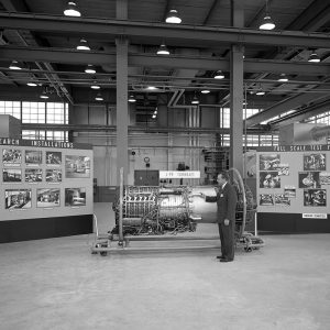 Martin Saari points to a GE J79 turbojet engine model at the PSL during an NACA Inspection talk in October 1957.