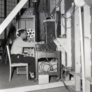 Man in chair with equipment.