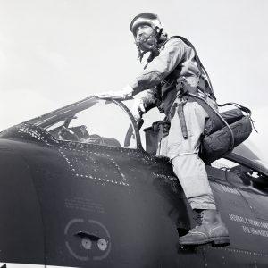 Pilot climbing in cockpit