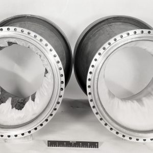 Two tubular thrust chambers with damage.