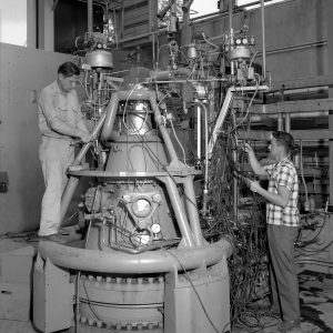 Two mechanics working on test stand.