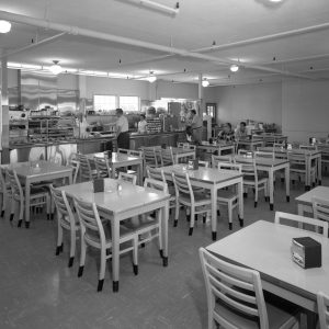 Tables and counter inside Cafeteria Building.
