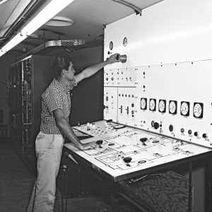 Operator at panel in control Room