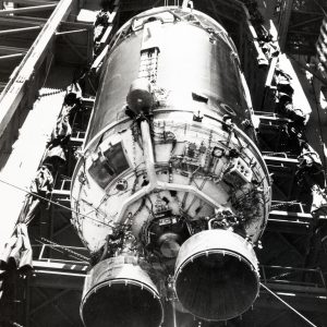 Centaur rocket hoisted into launch stand.