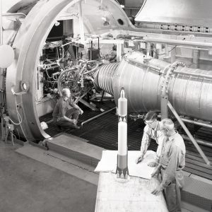 Men with engine in test cell