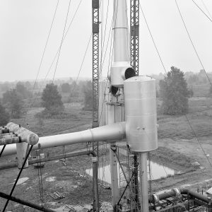 Crane lifting section of ejector into place.