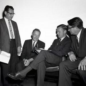 Men seated.