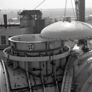 Crane lifts cap off the top of SPC No. 1 dome.