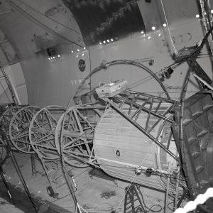 Engineers examine tubular Atlas-Centaur setup inside SPC No. 2.