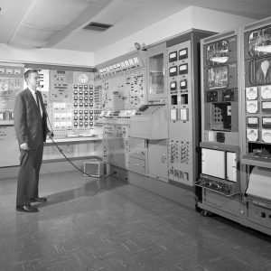 Man standing in control room.